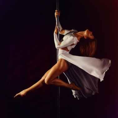 women s white crew neck long sleeve dress dancing on stainless steel pole